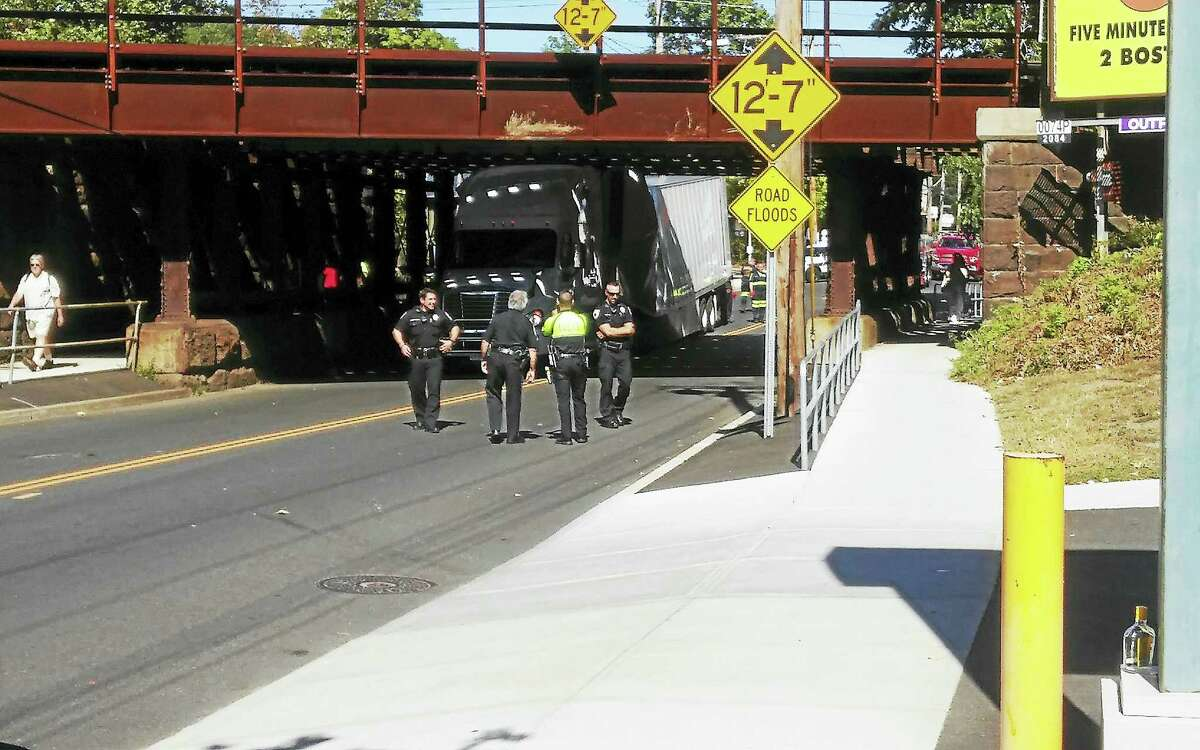 Photo by Joseph TomasoA tractor trailer is stuck under a train bridge in West Haven.