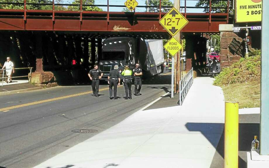 Photo by Joseph TomasoA tractor trailer is stuck under a train bridge in West Haven. Photo: Journal Register Co.