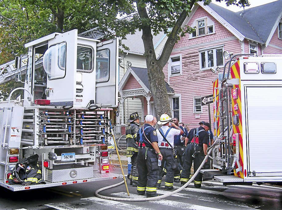 (Wes Duplantier/The New Haven Register)Fire damaged a home Wednesday morning at 203 Spring St. in New Haven. The flames were quickly knocked down and the cause of the fire remained under investigation. Photo: Journal Register Co.