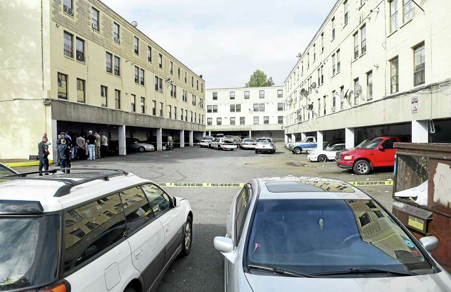 (Arnold Gold-New Haven Register)  New Haven and State Police investigate the scene of a man shot by police earlier in the morning at Church Street South in New Haven on 9/6/2016. Photo: Journal Register Co.