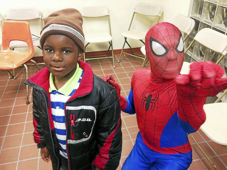 New Haven police hosted families in Westville for a Halloween night at the District 2 substation. Students from Southern Connecticut State University volunteered to dress in costumes, face paint, tattoo, and give candy to the kids. Photo: Digital First Media