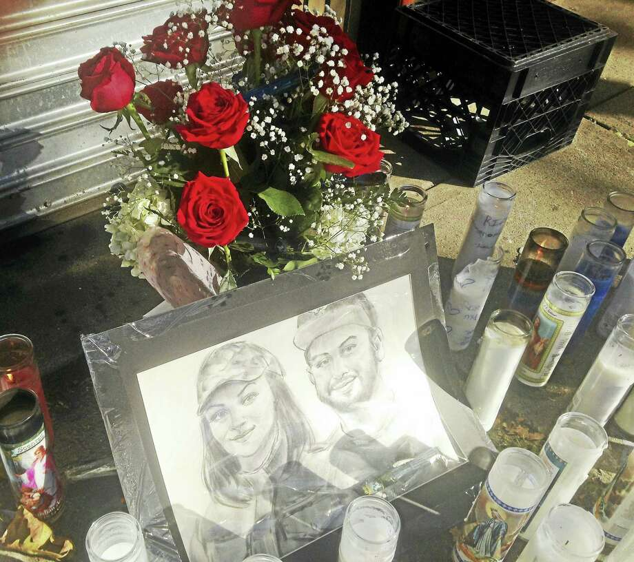 "Remains of a candlelight vigil held for Muhanad ""Momo"" Jawad, 21, of New Haven, who was killed at his store Tuesday afternoon. Photo: Digital First Media"