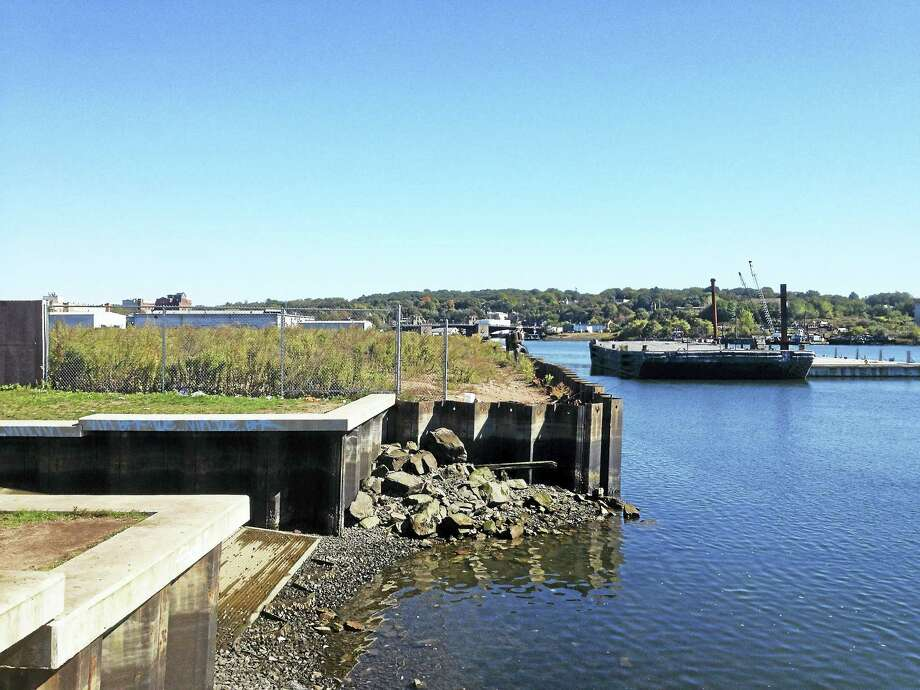Views of the Quinnipiac River running parallel to River Street that have to be cleaned up and a bulkhead installed. Since 2002, the city has planned to put in a pedestrian walkway and linear park along the river from James Street to the Ferry Street Bridge and then across to the Front Street park. Mary O'Leary - New Haven Register Photo: Digital First Media