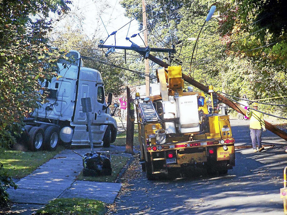 (Wes Duplantier/The New Haven Register)High Top Circle in Hamden was shut down at Pine Rock Avenue for hours Monday morning after a truck crashed into a utility pole, snapping it in half and taking down several hours. No one was hurt in the accident. Photo: Journal Register Co.
