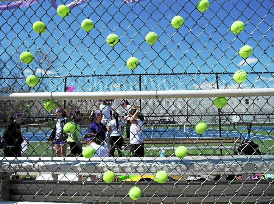(Peter Hvizdak - New Haven Register) The Law High School Girls' tennis team uses tennis balls to make a heart memorial in honor of Maren Sanchez Monday, April 28, 2014 at the school's tennis court. Photo: New Haven Register / ©Peter Hvizdak /  New Haven Register
