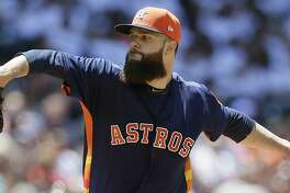 HOUSTON, TX - APRIL 30:  Dallas Keuchel #60 of the Houston Astros pitches in the fifth inning against the Oakland Athletics at Minute Maid Park on April 30, 2017 in Houston, Texas.  (Photo by Bob Levey/Getty Images)