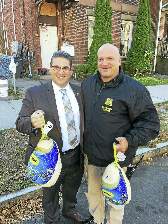 New Haven police work with community leaders in Fair Haven to give away Thanksgiving Day food baskets at Clinton Avenue School Wednesday Photo: Digital First Media