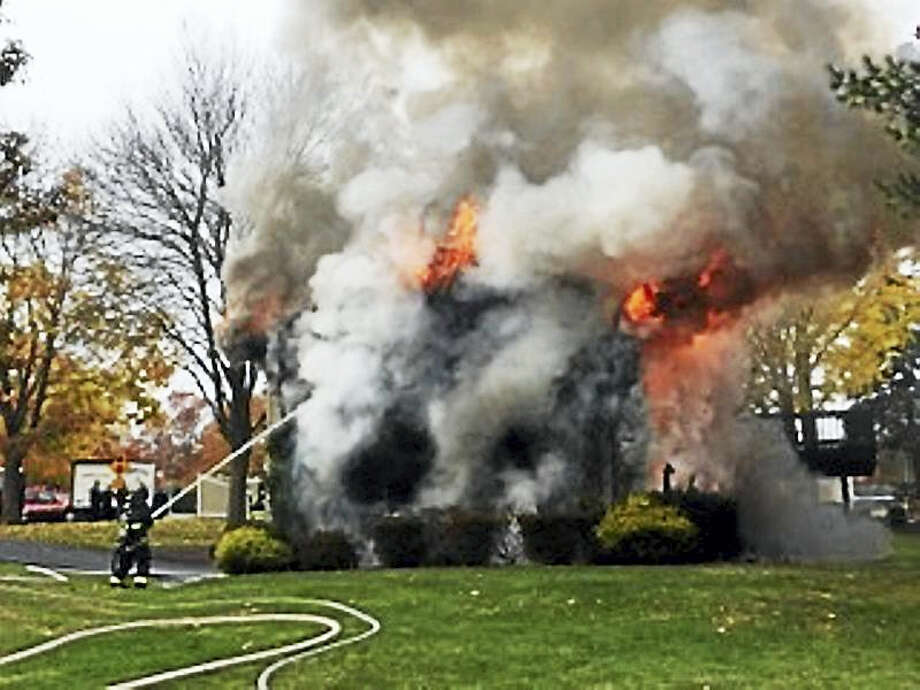 (Photo courtesy of William Gould)Hamden firefighters battled a blaze late Wednesday morning at 737 Choate Ave. Two people inside the home escaped without injury but three firefighters were being evaluated for minor burns, scrapes and bruises. Photo: Digital First Media