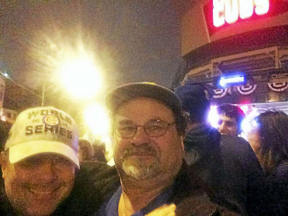 (Mark Zaretsky - New Haven Register) New Haven Register reporter Mark Zaretsky, a Chicago native, and his brother-in-law Michael Burke, who lives in Chicago but is originally from New London, celebrate outside Wrigley Field after the Cubs won the World Series Wednesday night. Photo: Digital First Media