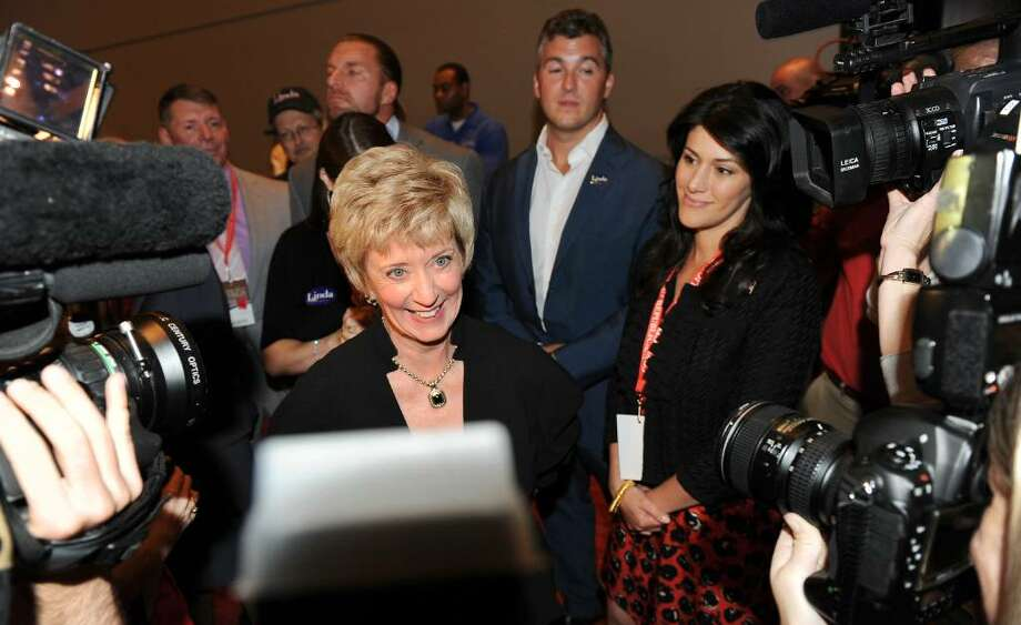 US Senate candidate Linda McMahon stands in the center of the media as she waits to hear the results of the nomination proccess at the GOP convention in downtown Hartford, Conn. on Friday May 21, 2010. Photo: Christian Abraham, ST / Connecticut Post