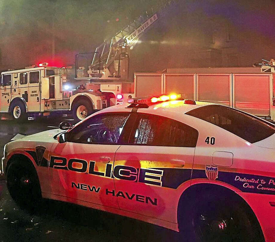 (Photo courtesy of the New Haven Fire Department)New Haven fire crews battled a two-alarm fire early Wednesday at 1471 Chapel St. Photo: Digital First Media
