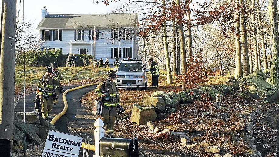 (Wes Duplantier/The New Haven Register)Crews from Branford and Guilford responded Tuesday morning after a fire broke out at a home on Granite Road. No one was hurt in the blaze. Photo: Digital First Media