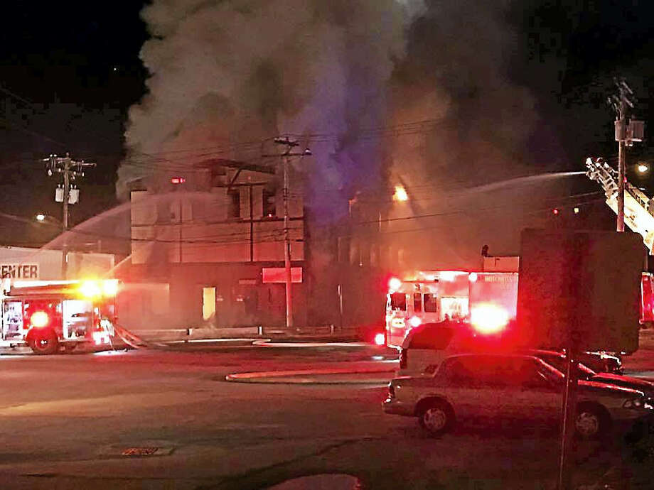 Photo courtesy of the Derby Fire Department Authorities are investigating after a three-alarm fire scorched a building at the corner of Main and Caroline streets early Sunday morning. Photo: Digital First Media