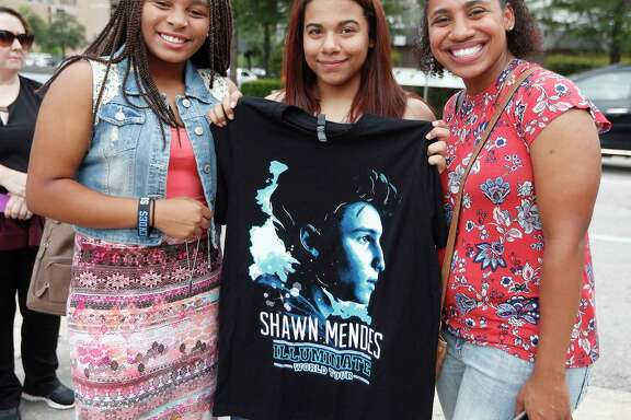 Fans of teen pop star Shawn Mendes wait in line outside of the Toyota Center, Saturday, July, 22, 2017.