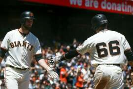 SAN FRANCISCO, CA - JULY 22: Gorkys Hernandez #66 of the San Francisco Giants is congratulated by Brandon Belt #9 after scoring a run against the San Diego Padres during the third inning at AT&T Park on July 22, 2017 in San Francisco, California.  (Photo by Jason O. Watson/Getty Images)