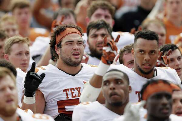 "Offensive tackle Connor Williams (center, with headband) of the Texas Longhorns sings ""The Eyes of Texas"" with teammates after the Orange-White spring game at Royal-Memorial Stadium on April 15, 2017 in Austin."