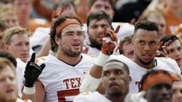 "Connor Williams of the Texas Longhorns sings ""The Eyes of Texas"" with teammates after the Orange-White spring game at Royal-Memorial Stadium on April 15, 2017 in Austin."