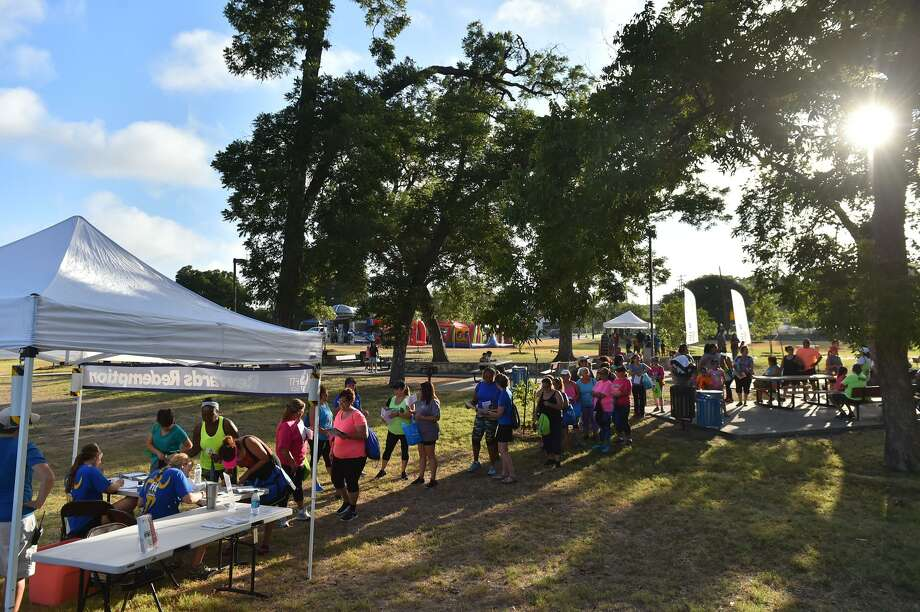 Visitors to the eighth annual Family Fitness Challenge line up to redeem their rewards points early Satudray mornig at Rossevelt Park. Photo: Robin Jerstad, Freelance / San Antonio Express News / ROBERT JERSTAD