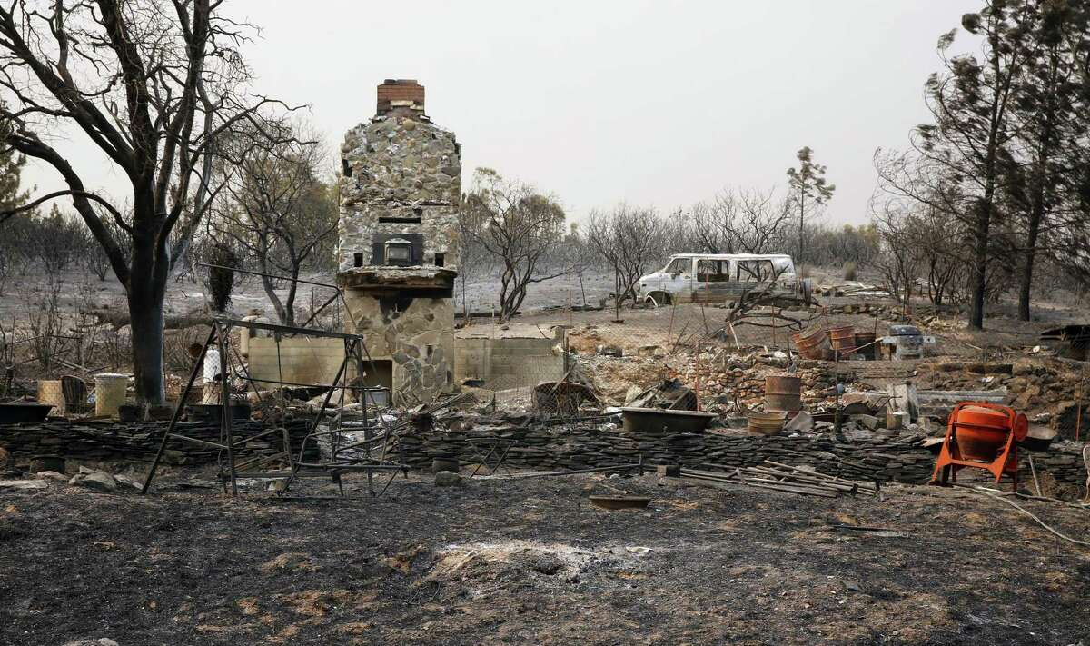 The stone chimney is all that is left after Jai and Miki Crawford's home burned to the ground in the Detwiler Fire in Mariposa County.