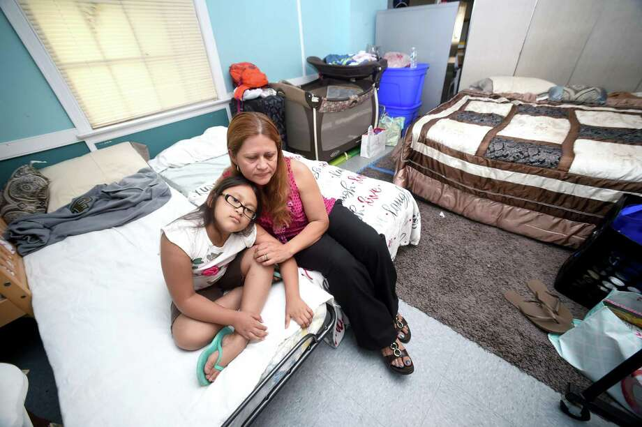 Hayley Chavarria (left), 9, is photographed with her mother, Nury Chavarria, of Norwalk in a room where the two are staying at Iglesia de Dios Pentecostal in the Fair Haven section of New Haven on 7/22/2017. Arnold Gold / Hearst Connecticut Media Photo: Arnold Gold / Hearst Connecticut Media