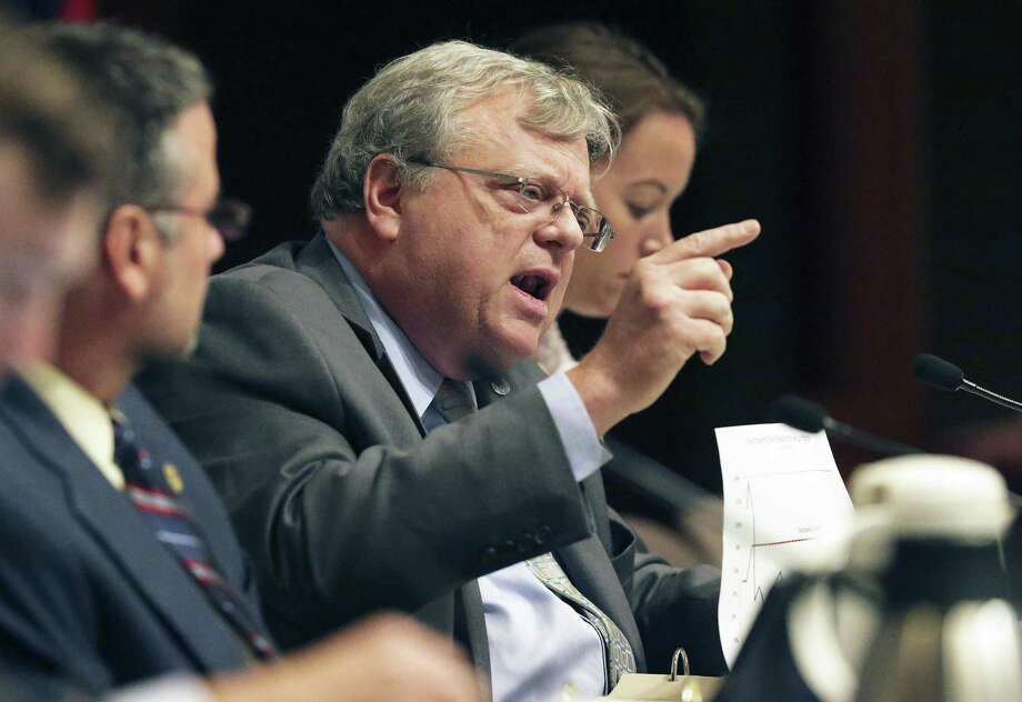 Senator Paul Bettencourt uses graphics to make a point while arguing with Bill Longley of the Texas Municipal League as the Senate Select Committee on Government Reform takes up SB 1 and other property tax bills on July 22, 2017. Photo: Tom Reel, Staff / San Antonio Express-News / 2017 SAN ANTONIO EXPRESS-NEWS