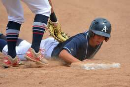 Bethel's Andy Rdizik slides safely back to first base on pickoff attempt by Trumbull during their regional final of the 17U American Legion tournament on Saturday in Bethel.