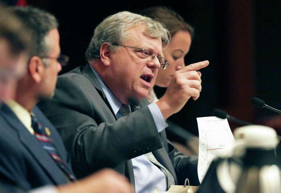 Senator Paul Bettencourt uses graphics to make a point while arguing with Bill Longley of the Texas Municipal League as the Senate Select Committee on Government Reform takes up SB 1 and other property tax bills on July 22, 2017. Photo: Tom Reel, Staff / 2017 SAN ANTONIO EXPRESS-NEWS