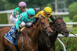 Lady Eli with jockey Irad Ortiz, Jr., left out duels Quidura with jockey Junior Alvarado up to win the 79th running of The Diana Saturday July 23, 2017 at the Saratoga Race Course in Springs, N.Y. (Skip Dickstein/Times Union)