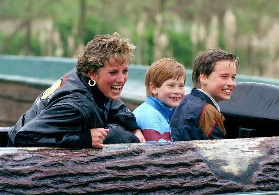 Princess Diana Enjoys A Theme Park Ride With Sons Harry Also At Right And