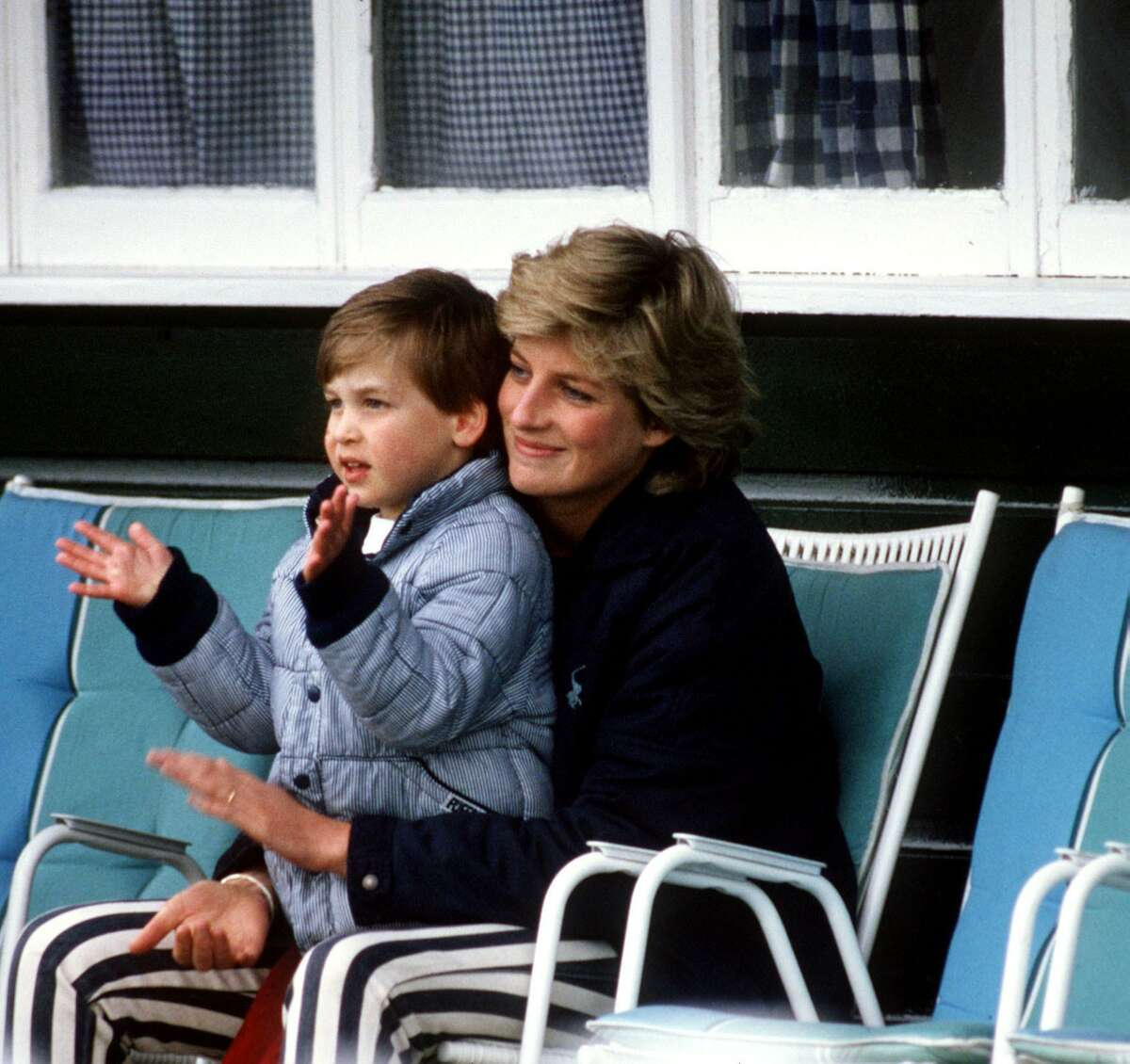 Prince William sits on his mother's lap in a photo that is shown on the HBO film about Princess Diana.