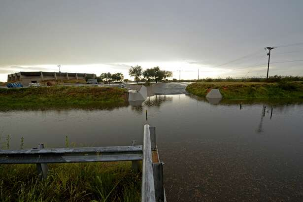 Rainwater drains past I Street near Midland College on July 22, 2017. James Durbin/Reporter-Telegram