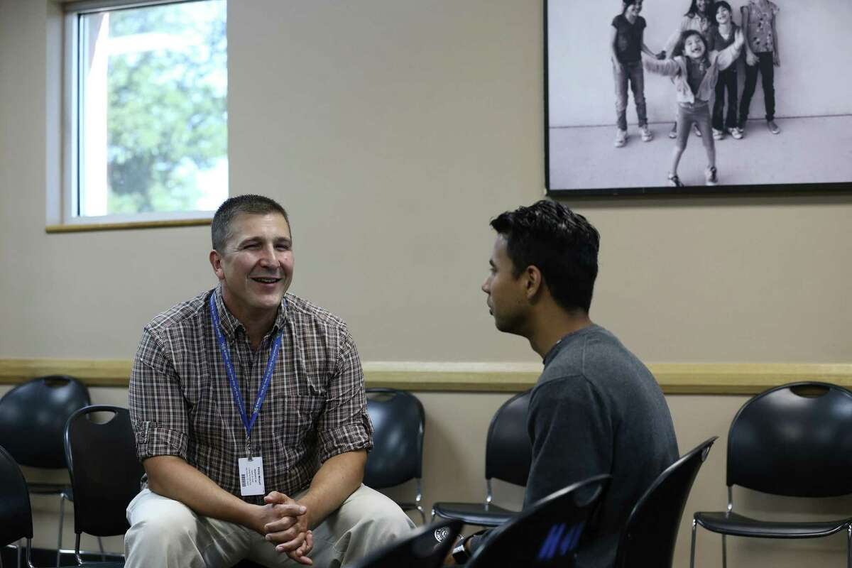 Haven for Hope social work intern, U.S. Army 1st. Lt. Phillip Metcalf, 46, left, works with Arturo Rodriguez, 24, Thursday, July 20, 2017. Metcalf was setting up Rodriguez with the free education and career technical training program, Gary Job Corps.