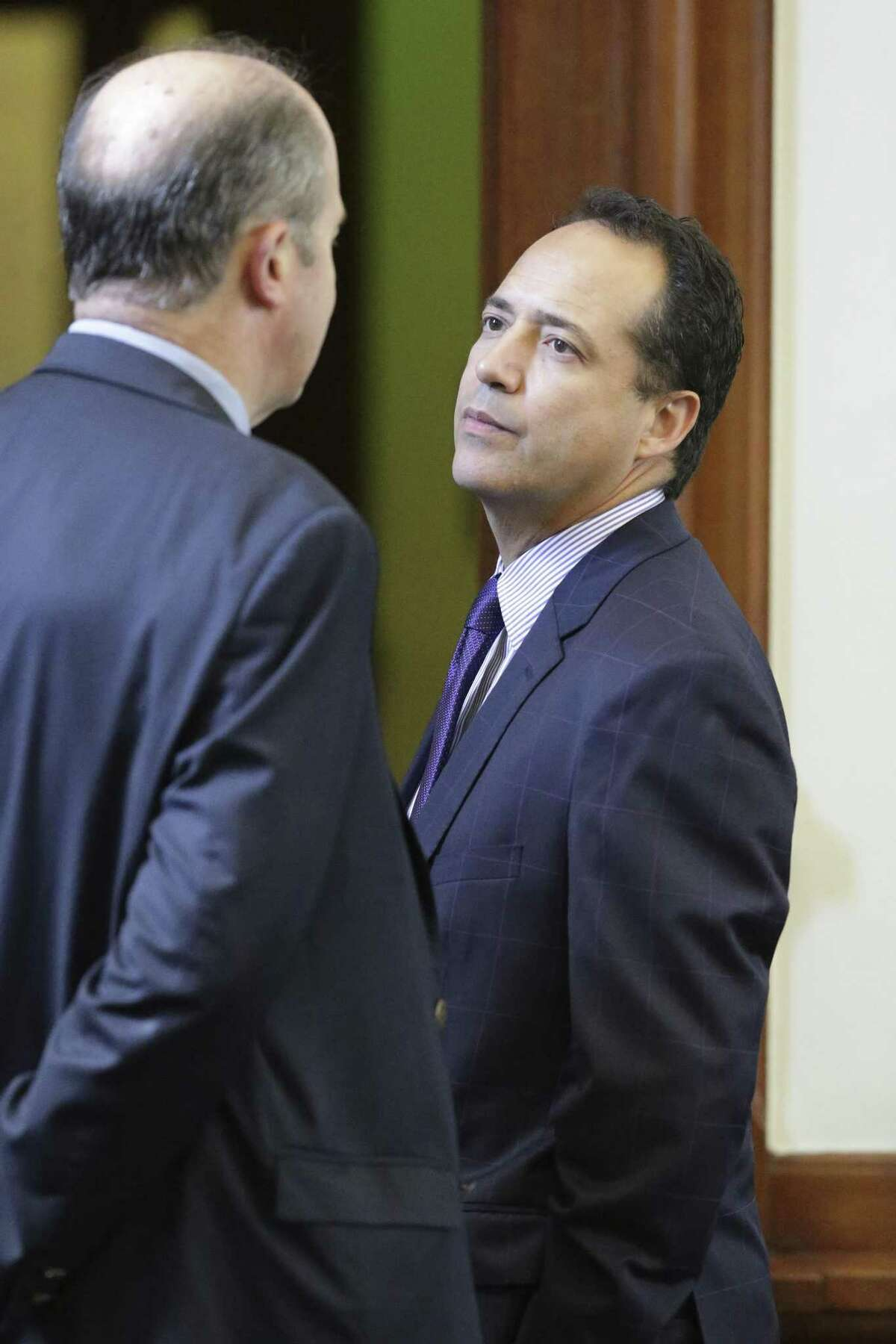 Senator Jose Menendez, D-San Antonio, listens to input just off the floor on the second day of the special legislative session on July 18, 2017.