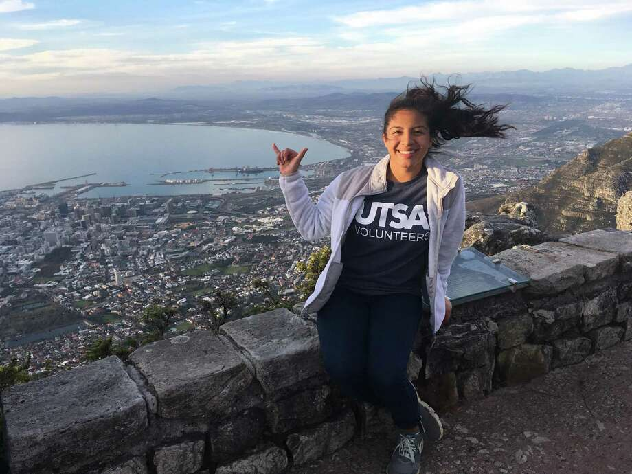 Brianna Diaz, 19, enjoys the view after she completed the hike up Table Mountain in Cape Town, South Africa, during her six-week immersion in Durban, South Africa this summer. She'll be a junior this fall, enrolled in the UTSA Top Scholars program, which has a study abroad requirement. Diaz, who is majoring in psychology with minors in both math and civic engagement, opted for the School for International Trainings six-week education program in South Africa. Photo: Courtesy /Courtesy