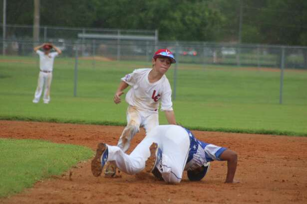League City second baseman Chase Bourgeois applies the tag on a Titans player during second-inning action Saturday afternoon. Bourgeois had a strong game with the glove, accounting for six of the 12 Brownsville outs.