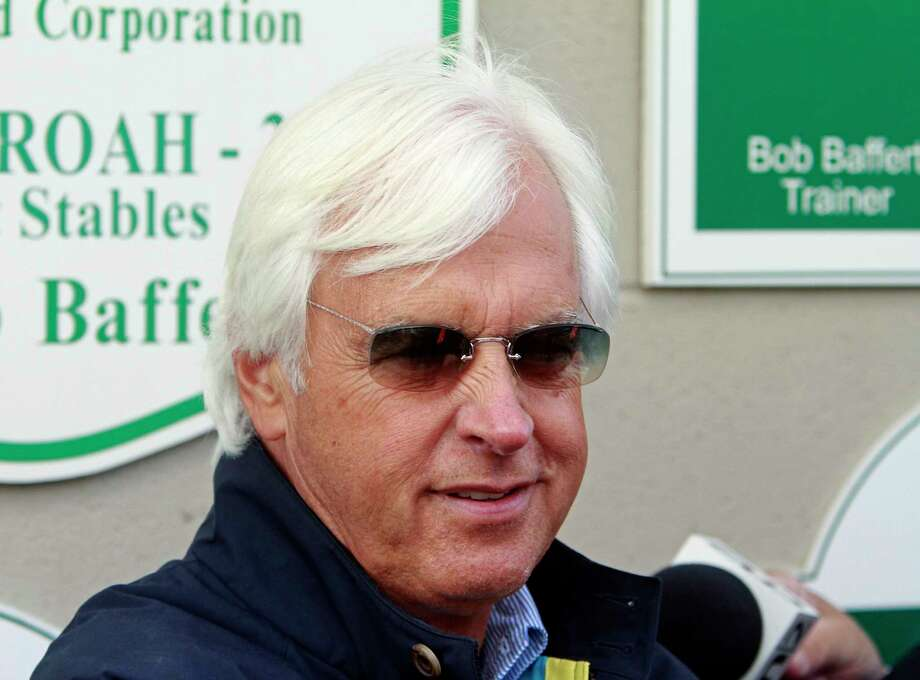 Hall of Fame trainer Bob Baffert, who won the Triple Crown last year with American Pharoah, talks about the 142nd Kentucky Derby outside Barn 33 at Churchill Downs in Louisville, Ky., Monday, May 2, 2016. The 142nd Kentucky Derby is Saturday, May 7. (AP Photo/Garry Jones) ORG XMIT: KYGJ111 Photo: Garry Jones / FR50389 AP