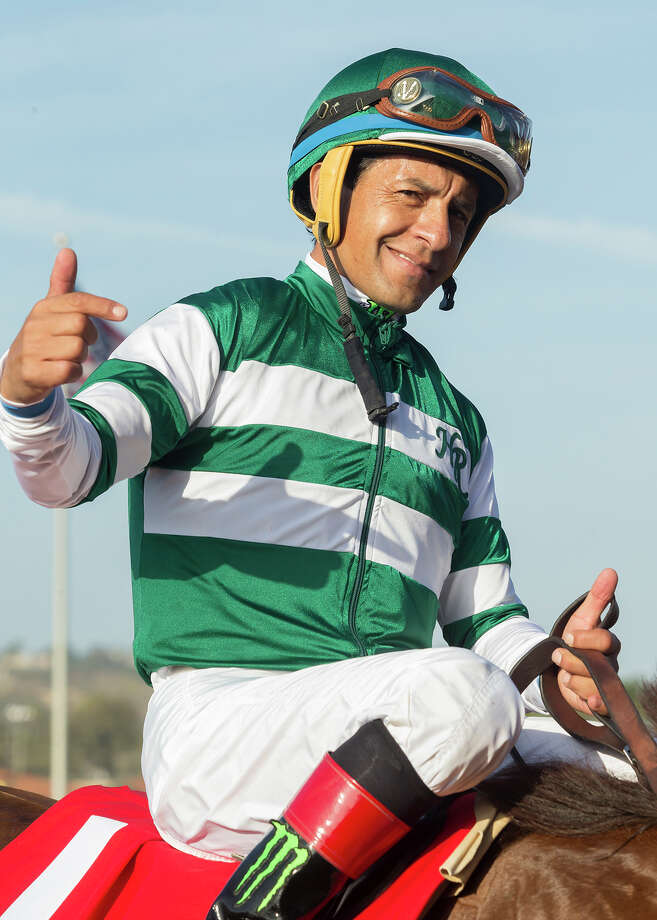 In a photo provided by Benoit Photo, jockey Victor Espinoza celebrates aboard Accelerate after their victory in the Grade II, $300,000 TVG San Diego Handicap horse race Saturday, July 22, 2017, at Del Mar Thoroughbred Club in Del Mar, Calif. (Benoit Photo via AP) ORG XMIT: ARC114 / © BENOIT PHOTO