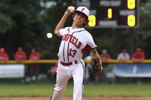 Ethan Righter (13) of Fairfield American delivers a pitch during the Little League Section 1 Championship Game against North Branford at Old Tavern Road Recreational Complex on July 22, 2017 in Orange, Connecticut.