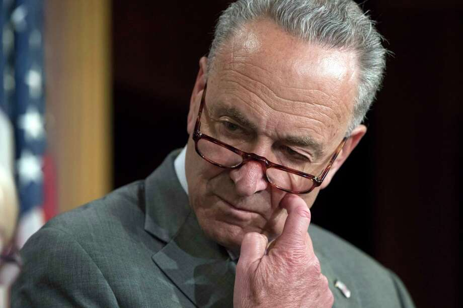 "In this July 13, 2017 photo, Senate Minority Leader Chuck Schumer of N.Y. pauses during a news conference on Capitol Hill in Washington.  Congressional Democrats announced Saturday that a bipartisan group of House and Senate negotiators have reached an agreement on a sweeping Russia sanctions package to punish Moscow for meddling in the presidential election and its military aggression in Ukraine and Syria.  Schumer called the sanctions legislation ""strong"" and he expected the legislation to be passed promptly.  (AP Photo/J. Scott Applewhite) ORG XMIT: WX105 Photo: J. Scott Applewhite / Copyright 2017 The Associated Press. All rights reserved."