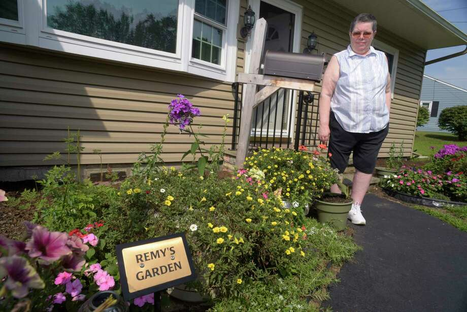Lee Burns stands near a garden outside her home that is in memory of her cat Remy on Thursday, July 20, 2017, in Colonie, N.Y.  Remy had to be put to sleep in 2014.  Burns was able to put Remy to sleep at her home with the services of Anne Fay DVM Mobile Vet. (Paul Buckowski / Times Union) Photo: PAUL BUCKOWSKI / 20041096A