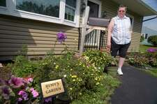Lee Burns stands near a garden outside her home that is in memory of her cat Remy on Thursday, July 20, 2017, in Colonie, N.Y.  Remy had to be put to sleep in 2014.  Burns was able to put Remy to sleep at her home with the services of Anne Fay DVM Mobile Vet. (Paul Buckowski / Times Union)