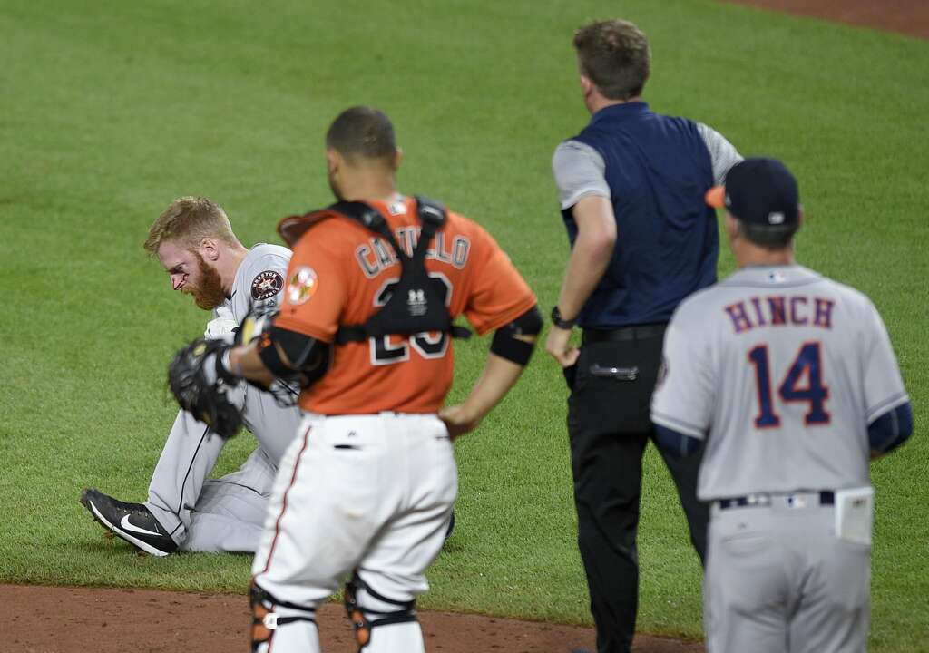 A Trainer And Houston Astros Manager AJ Hinch 14 Run To The Aid Of