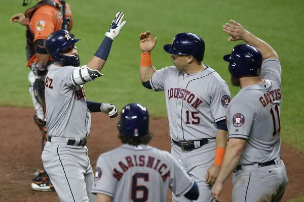 Houston Astros' Marwin Gonzalez, left, celebrates his three-run home run with Carlos Beltran (15), Evan Gattis (11) and Jake Marisnick (6) during the sixth inning of a baseball game against the Baltimore Orioles, Saturday, July 22, 2017, in Baltimore. (AP Photo/Nick Wass)