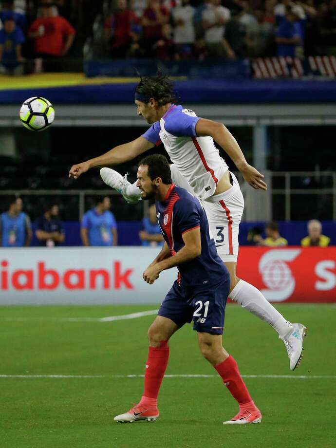 United States' Omar Gonzalez, right, jumps for the ball next to Costa Rica's Marco Urena during a CONCACAF Gold Cup semifinal soccer match in Arlington, Texas, Saturday, July 22, 2017. (AP Photo/LM Otero) ORG XMIT: CBS101 Photo: LM Otero / Copyright 2017 The Associated Press. All rights reserved.