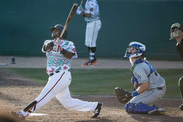 Pablo Sandoval hits a fly out during his second time at bat in his first game for the San Jose Giants as a designated hitter on Saturday, July 22, 2017 in San Jose, CA.