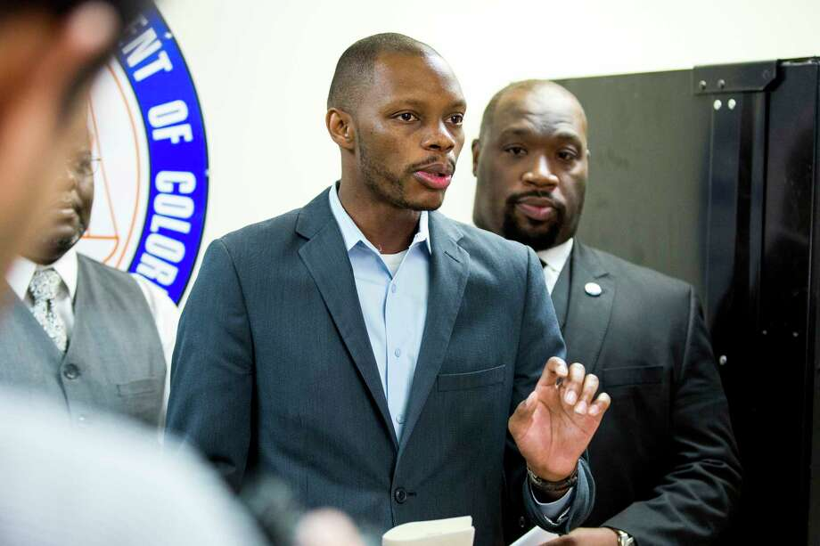 FILE - In this June 5, 2017, file photo, Arizona state Democratic Rep. Reginald Bolding Jr., left, calls on Gov. Doug Ducey to remove six confederate monuments in Arizona during a news conference by the NAACP and Black Lives Matter in Phoenix, Ariz. Bolden successfully pushed for changes in the state's driving rules that inform gun-carrying motorists how they should handle themselves if they get pulled over by police officers. (AP Photo/Angie Wang, File) ORG XMIT: PDX508 Photo: Angie Wang / Copyright 2017 The Associated Press. All rights reserved. This m