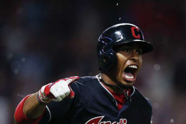 CLEVELAND, OH - JULY 22: Francisco Lindor #12 of the Cleveland Indians celebrates after hitting a game winning solo home run off Danny Barnes #24 of the Toronto Blue Jays during the tenth inning at Progressive Field on July 22, 2017 in Cleveland, Ohio. The Indians defeated the Blue Jays 2-1 in ten innings. (Photo by Ron Schwane/Getty Images) ORG XMIT: 700011713