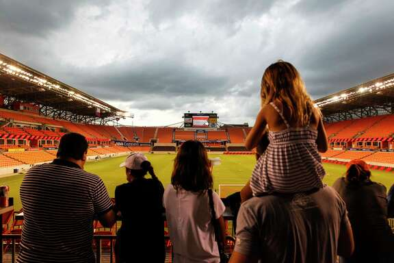 Houston Dash fans waiting on the concourse while the game against Boston Breakers is delayed due to lightning and thunder at BBVA Compass Stadium Saturday, July 22, 2017, in Houston. ( Yi-Chin Lee / Houston Chronicle )