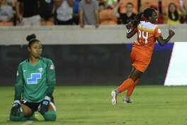 Dash forward Nichelle Prince (14) celebrates scoring a first-half goal, which ended up standing as the lone goal of the game Saturday in a 1-0 victory over the Boston Breakers at BBVA Compass Stadium.
