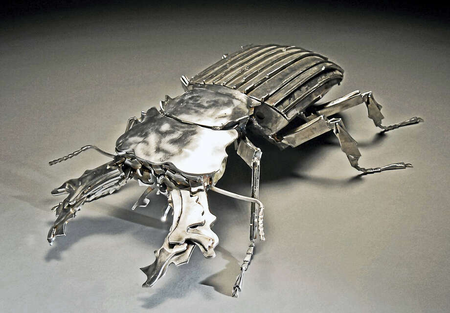 "Courtesy Peabody Museum BEETLE MANIA: Working from a photograph by William Guth of a mountain stag beetle from Sabeh, East Malaysia, Gar Waterman produced this metal sculpture of a stag beetle as part of the new Yale Peabody Museum of Natural History exhibition ""Beauty and the Beetle: Coleoptera in Art and Science,"" running May 27 through Aug. 6. The exhibit combines select beetle specimens from the Peabody collections with larger than life beetle-inspired art New Haven's  Waterman and Bethany's Guth. Photo: Digital First Media"